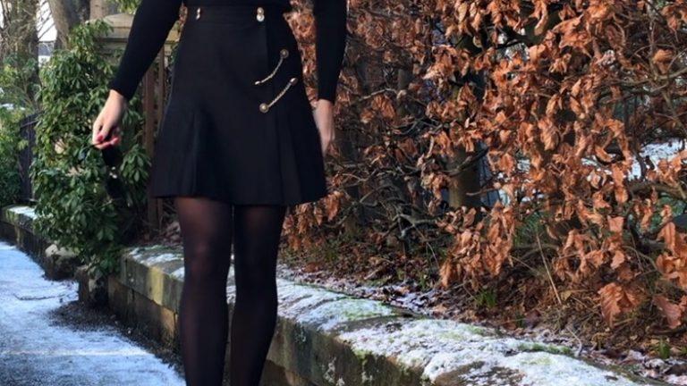 blonde girl in kilt and beret