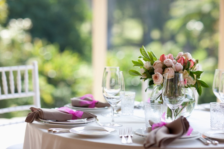A beautiful dining table with flowers
