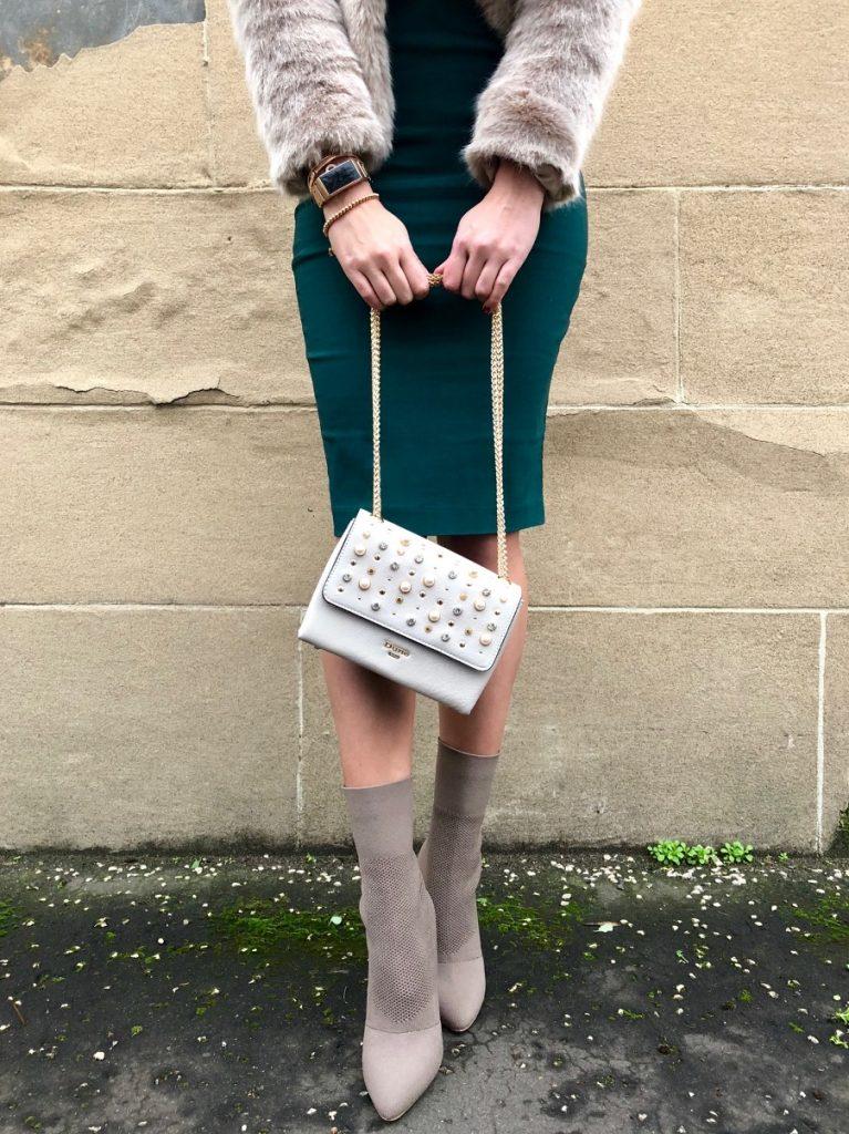 Girl holding chain strap of bag