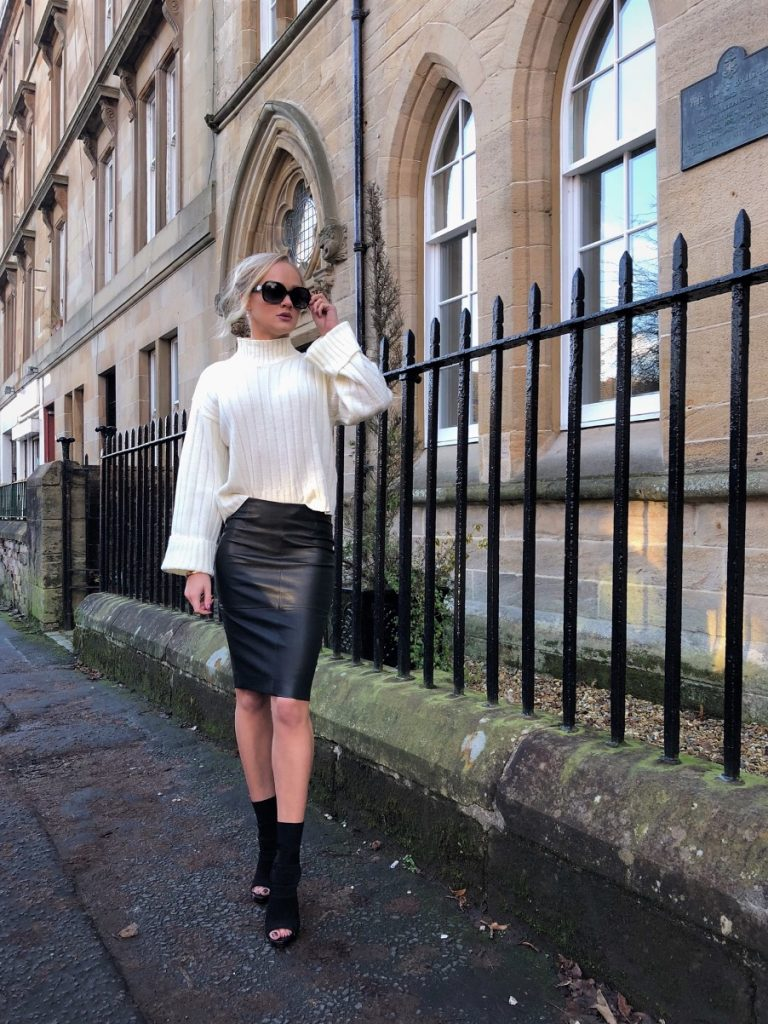 GIrl in leather skirt and chunky sweater