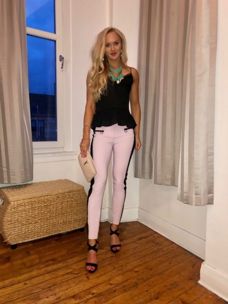 Pink Versace pants with peplum top and turquoise necklace style