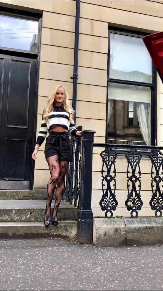 black tailored shorts with patterned tights