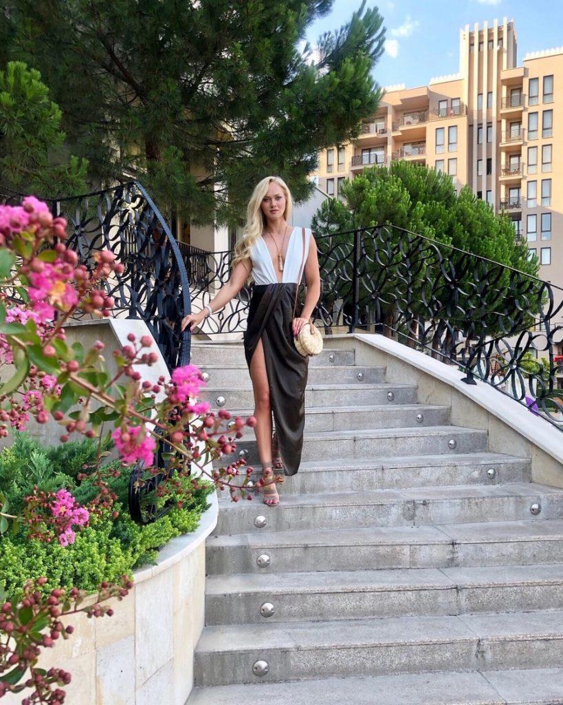 long khaki satin skirt on beautiful steps