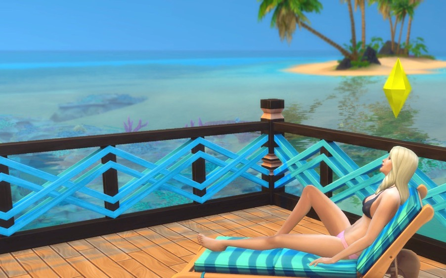 The Sims 4 as self care - sim relaxing at the beach