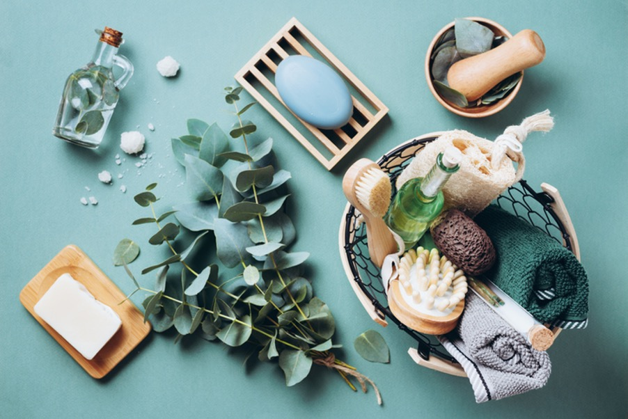Self care spa day accessories including eucalyptus, oils and a dry brush