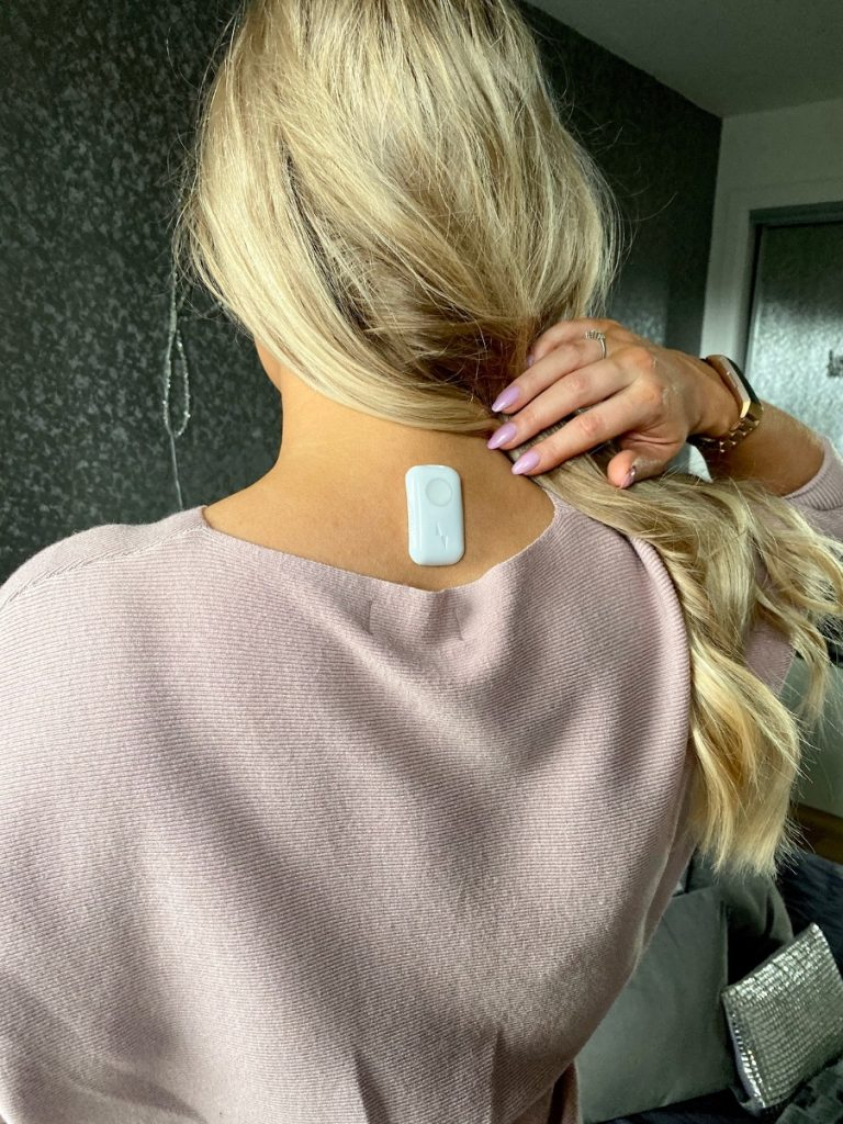 Upright Go Posture Tracker on back for wellness