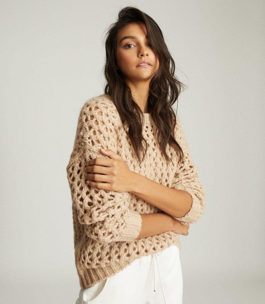 Girl in crochet knit jumper - beige