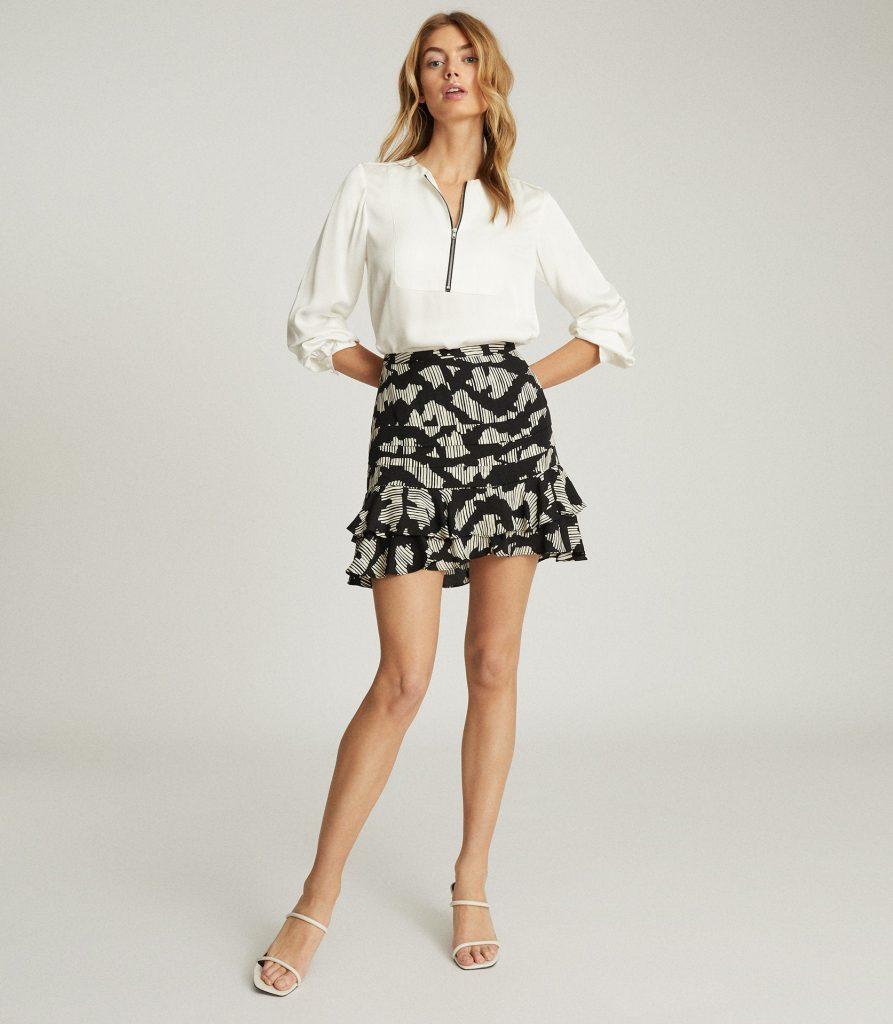 Ruffle mini skirt in black and white print