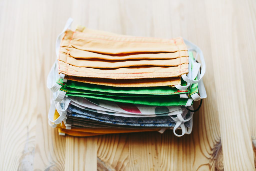Pile of reusable face masks that can cause maskne