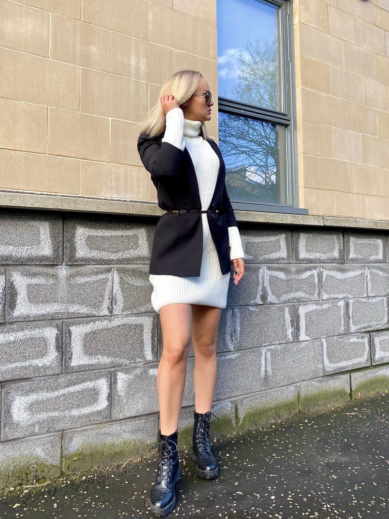 Girl wearing blazer over knit roll neck dress