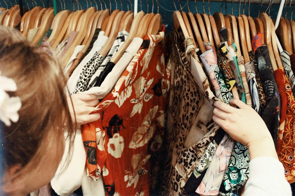 woman browsing clothing on a rack