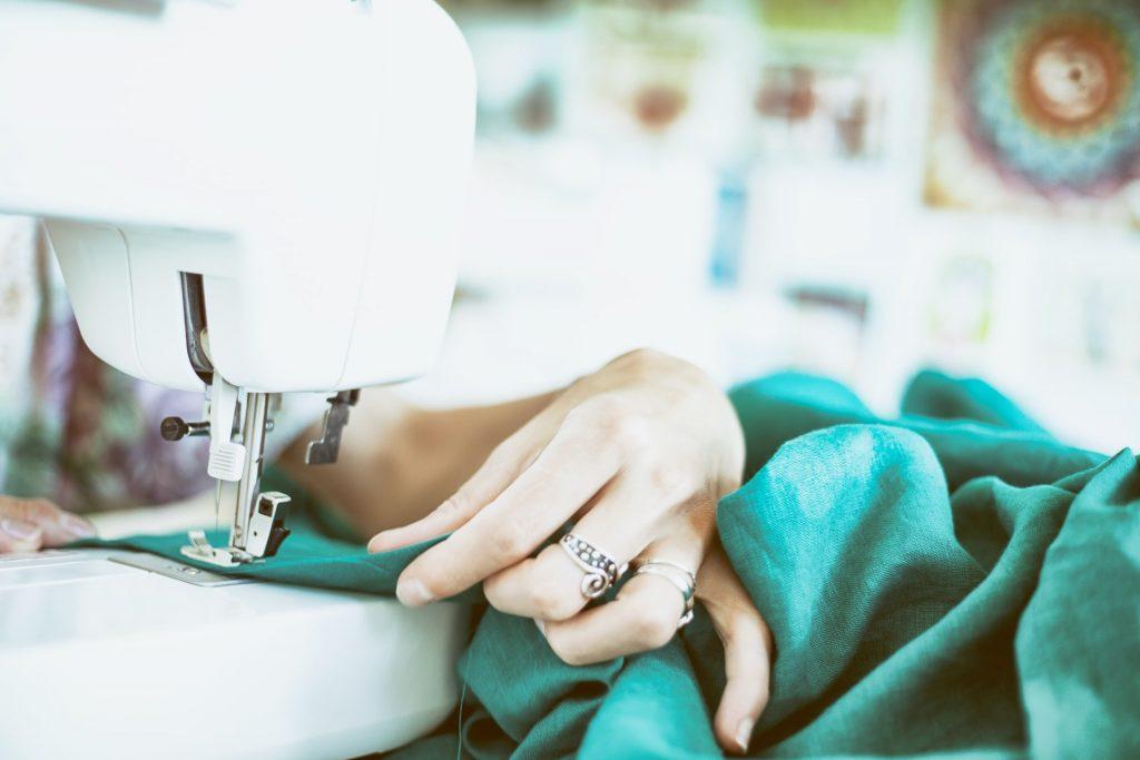 seamstress altering fashion on a machine in 2021